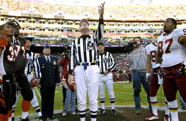 How does the coin toss work in football?