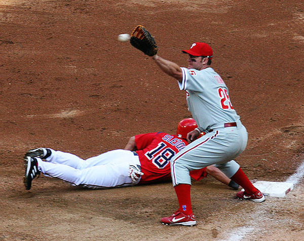 "What does ""the play is to"" 1st, 2nd, or 3rd base mean in baseball?"