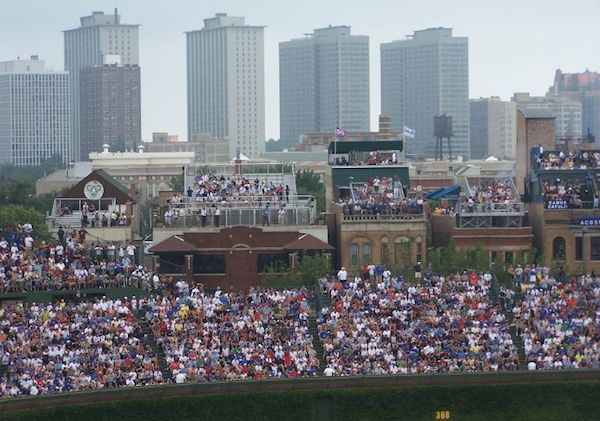 Who owns the rooftop seating near Wrigley Field?