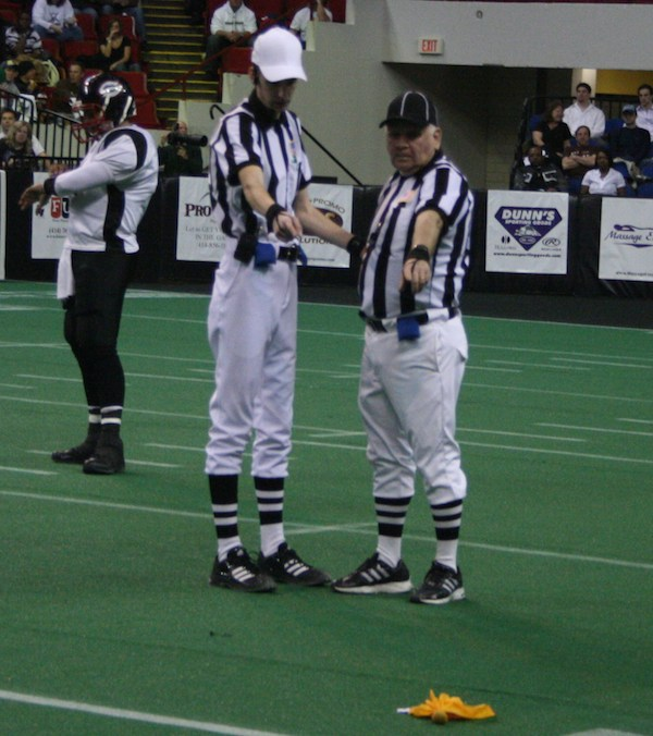 Why does an NFL ref throw his hat on the field?