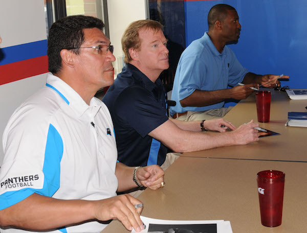 Photo by Reginald Rogers/Paraglide Carolina Panther head coach Ron Rivera, left, NFL Commissioner Roger Goodell and former Carolina Panthers player Mike Rucker sign autographs and photos for Soldiers at the 1st Brigade Combat Team dining facility Friday during their visit to the post.